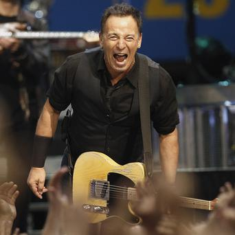 Musician Bruce Springsteen is an inspiration to Australian economics, according to the country's finance minister (AP)