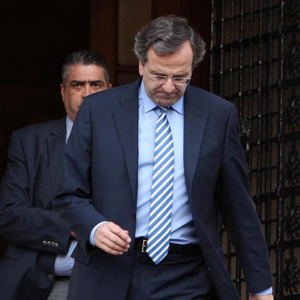 Greek Prime Minister Antonis Samaras after his meeting with the other political leaders of the coalition government (AP)