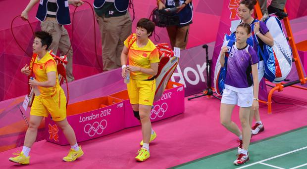LONDON, ENGLAND - JULY 31: Wang Xiaoli and Yang Yu of China leave the court with Ha Na Kim and Kyung Eun Jung of Korea after their Women's Doubles Badminton on Day 4 of the London 2012 Olympic Games at Wembley Arena on July 31, 2012 in London, England. (Photo by Michael Regan/Getty Images)