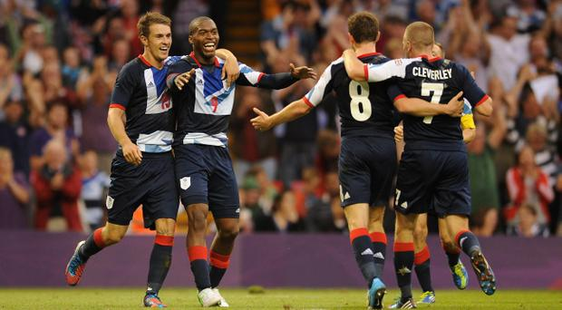 Great Britain's Daniel Sturridge (2nd left) celebrates with his team mates after he scores their side's first goal of the game during the group A match against Uruguay at the Millennium Stadium, Cardiff