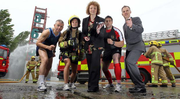 Sports Minister Carál Ni Chuilín and John Tully, Chief Executive 2013 WPFG have stop watches at the ready to begin the countdown to next year's World Police and Fire Games. Limbering up are, from left, Colin Ward from the Prison Service, Lindsey Elwood from NIFRS, and Steve Welsh from PSNI