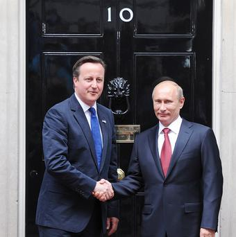 Prime Minister David Cameron greets Russian President Vladimir Putin on the steps of 10 Downing Street in London