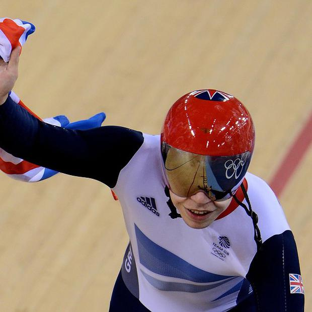 Great Britain's Chris Hoy celebrates winning gold in the men's team sprint during day six of the Olympic Games