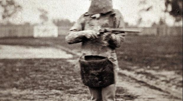 Australia's most infamous criminal Ned Kelly holds a gun in Melbourne (AP/State Library of Victoria)