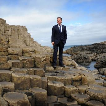 Prime Minister David Cameron stands on the Giant's Causeway in County Antrim