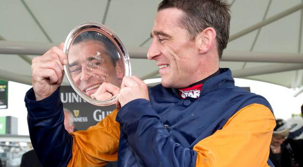 On reflection: Davy Russell celebrates winning The Guinness Galway Hurdle Handicap on Rebel Fitz at the Galway Summer Festival