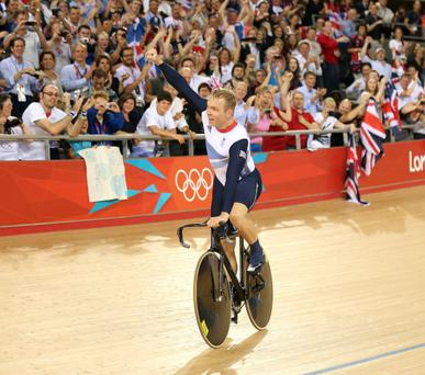 Winner: Sir Chris Hoy thanks the fans after setting a new world record and winning gold in the Men's Team Sprint Track Cycling final.