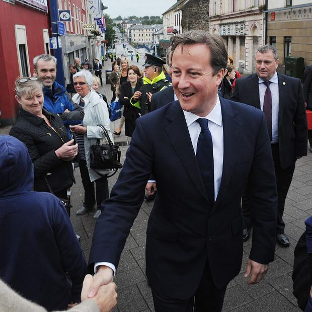 Prime Minister David Cameron meets shoppers in Coleraine High Street during his visit to Northern Ireland