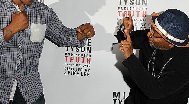 Mike Tyson and director Spike Lee pose backstage at the Mike Tyson Undisputed Truth show in New York (Donald Traill/Invision/AP)