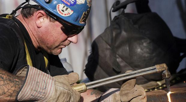 Some 163,000 jobs were added to the US economy in July but the unemployment rate still rose (AP)