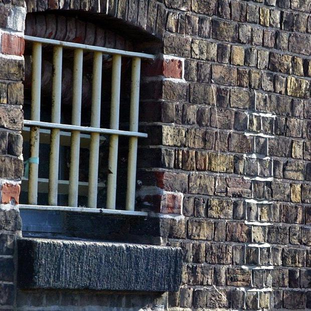 A prison chief has been charged with misconduct