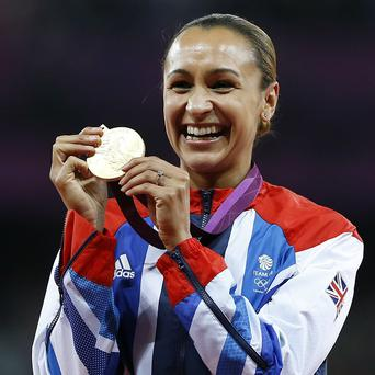 Jessica Ennis poses with her gold medal for the heptathlon (AP/Daniel Ochoa De Olza)