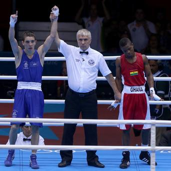 Michael Conlan, left, was pleased to get his Olympic campaign under way