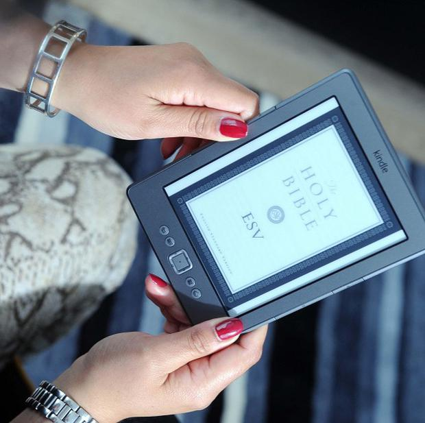 Amazon sold 114 Kindle titles for every 100 print books this year