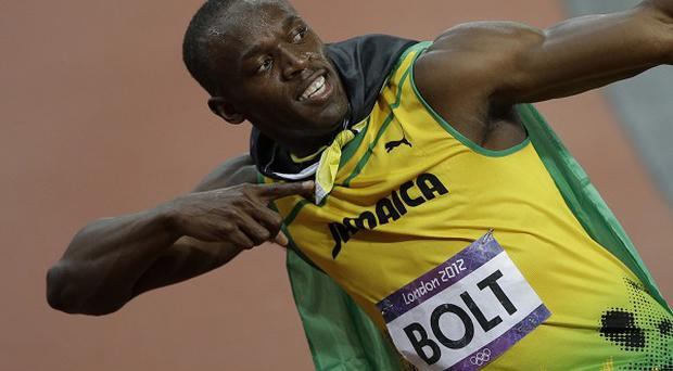 Usain Bolt in his trademark pose after winning the men's 100-metres final (AP/Matt Slocum)