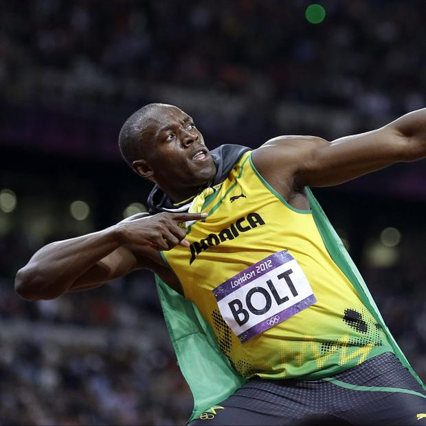 Usain Bolt displays his trademark pose after his win in the men's 100m final (AP/Anja Niedringhaus)