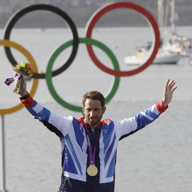 Ben Ainslie celebrates after winning the gold medal of the Finn class sailing (AP/Francois Mori)