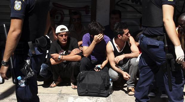 Greek police round up suspected illegal immigrants in Athens (AP)