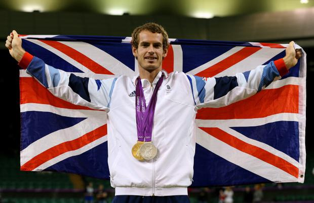 LONDON, ENGLAND - AUGUST 05: Andy Murray of Great Britain poses with his gold and silver medals holding a union jack after the medal ceremony for the Mixed Doubles Tennis on Day 9 of the London 2012 Olympic Games at the All England Lawn Tennis and Croquet Club on August 5, 2012 in London, England. (Photo by Clive Brunskill/Getty Images)