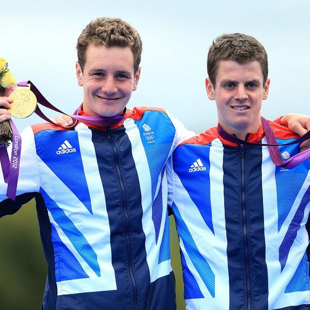 Brothers Alistair and Jonathan Brownlee celebrate winning gold and silver respectively in the Olympic triathlon