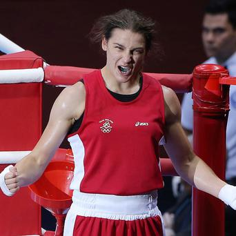 Katie Taylor, pictured, defeated Natasha Jonas to reach the Olympic semi-finals