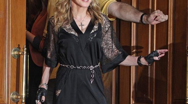 Madonna has voiced hope that the band members are released soon