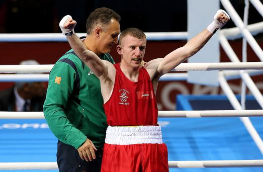 Ireland's Paddy Barnes (red) with head coach Billy Walsh celebrates after securing a Bronze medal in his Men's Boxing Light Flyweight bout against India's Devendro Singh Laishram at the Excel Arena, London