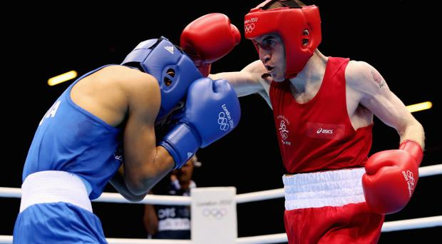 LONDON, ENGLAND - AUGUST 08: Paddy Barnes of Ireland in action against Devendro Singh Laishram of India during the Men's Light Fly (49kg) Boxing quarterfinals on Day 12 of the London 2012 Olympic Games at ExCeL on August 8, 2012 in London, England. (Photo by Scott Heavey/Getty Images)