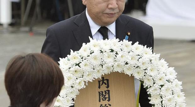 Japanese Prime Minister Yoshihiko Noda lays a wreath during a ceremony to mark the 67th anniversary of the Nagasaki atomic bomb attack (AP/Kyodo)