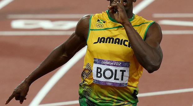 Jamaica's Usain Bolt celebrates winning the men's 200m final at the Olympic Stadium in London