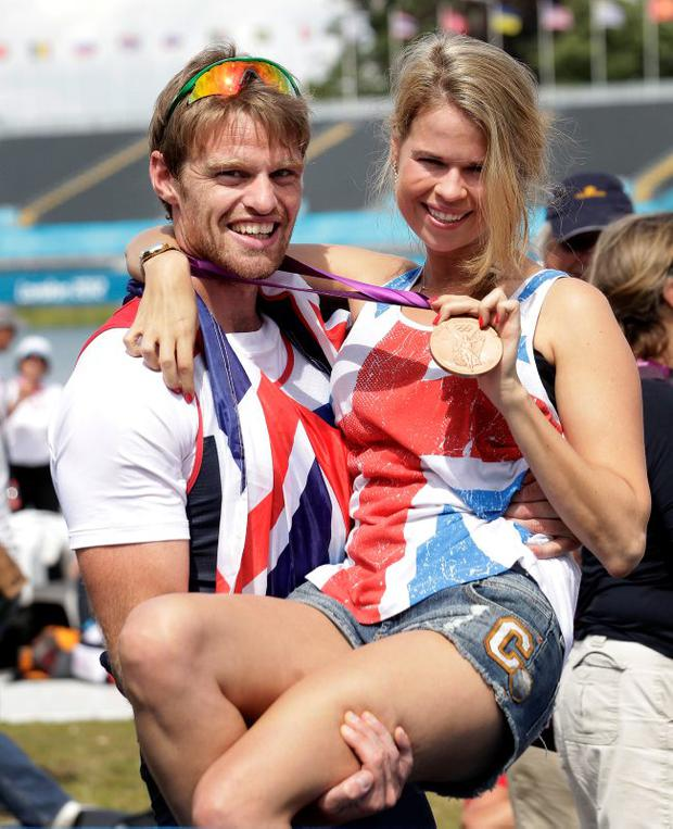 Unbridled joy: Alan Campbell celebrates his bronze with wife Jules