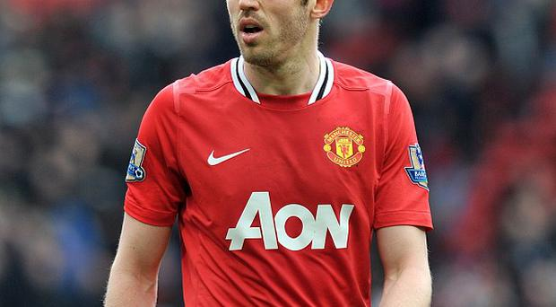 Michael Carrick may be forced into a defensive role this season