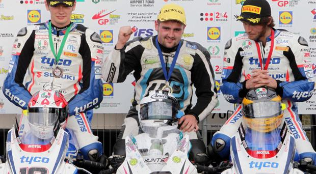Dundrod Superbike winner Michael Dunlop (centre) with TAS duo Guy Martin, runner-up, and Conor Cummins (left) who was third