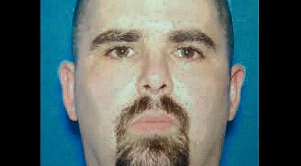 Wade Michael Page killed six people at a Sikh temple in Wisconsin before shooting himself in the head (AP)