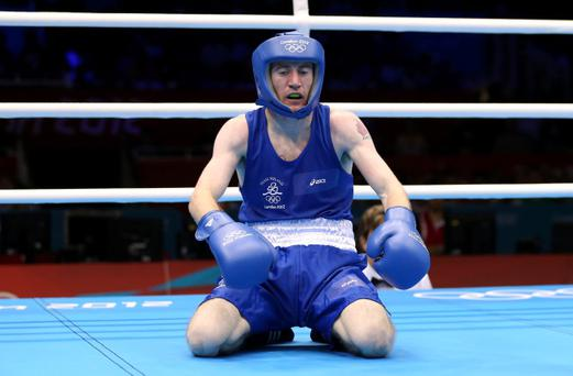 LONDON, ENGLAND - AUGUST 10: Paddy Barnes of Ireland sits up on the canvas as he competes against Shiming Zou of China during their Men's Light Fly (49kg) Boxing Semifinal bout on Day 14 of the London 2012 Olympic Games at ExCeL on August 10, 2012 in London, England. (Photo by Scott Heavey/Getty Images)