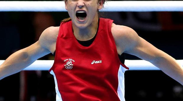 Katie Taylor celebrates winning the gold medal