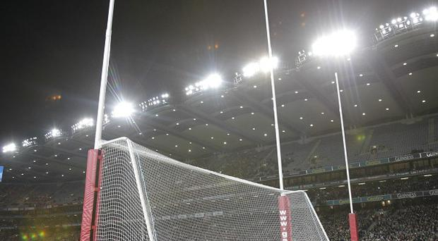 A minute's silence was held at Croke Park in memory of sport's writer Con Houlihan, whose funeral has taken place