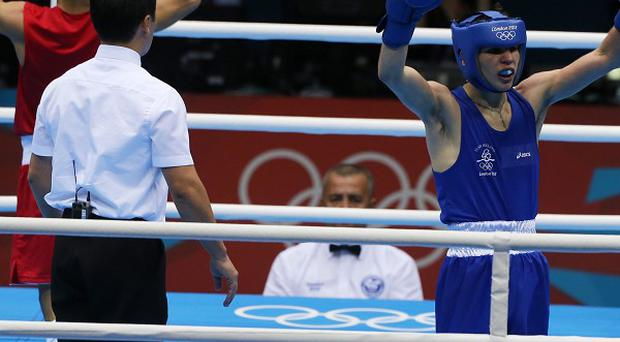 Michael Conlan celebrates his win over France's Nordine Oubaali
