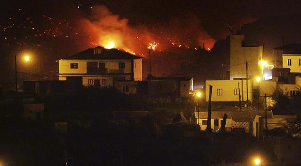 Wildfire advances on residential areas in La Gomera, Spain (AP)