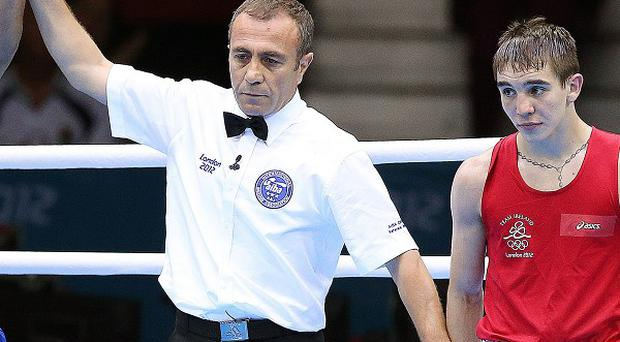 Michael Conlan, right, claimed Olympic bronze for Ireland