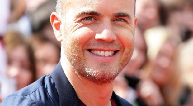 Gary Barlow has performed with his Take That bandmates at the Olympic closing ceremony