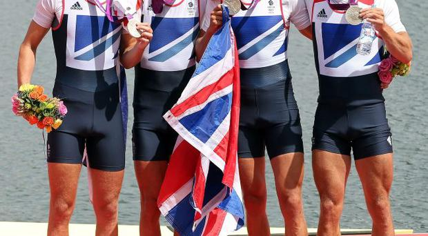 Chris Bartley, Richard Chambers, Rob Williams and Peter Chambers of Great Britain celebrate with their silver medals during the medal ceremony for the Lightweight Men's Four final on Day 6 of the London 2012 Olympic Games