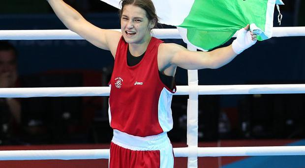 Katie Taylor celebrates winning her fight with Russia's Sofya Ochigava in London