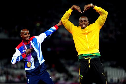 Mo Farah (left) celebrating his victory in the Men's 5000 metres with Jamaica's Usain Bolt at the Olympic Stadium, London. The two men performed each other's celebrations for the cameras