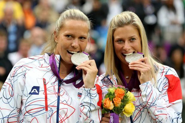 Silver medalists Lucie Hradecka of Czech Republic and Andrea Hlavackova of Czech Republic celebrate during the medal ceremony for the Women's Doubles Tennis on Day 9 of the London 2012 Olympic Games
