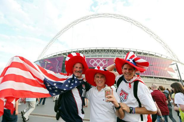 United States fans pose outside Wembley Stadium before the USA takes on Japan in the Women's Football gold medal match on Day 13 of the London 2012 Olympic Games
