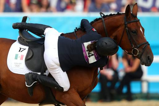 Tamara Vega of Mexico riding Douce de Roulad from her mount during the Riding Show Jumping in the Women's Modern Pentathlon on Day 16 of the London 2012 Olympic Games