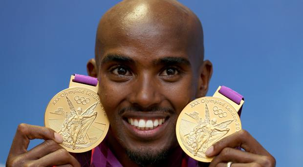 Great Britain's Mo Farah with the two Olympic gold medals he won in the Men's 10,000, and 5000m