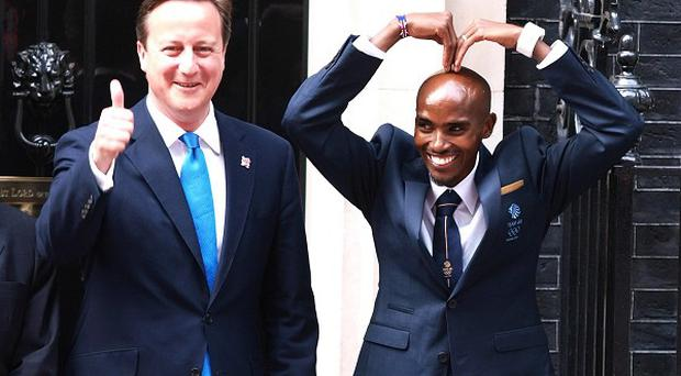Prime Minister David Cameron with newly crowned double Olympic champion Mo Farah outside 10 Downing Street
