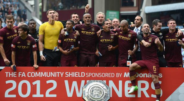BIRMINGHAM, ENGLAND - AUGUST 12: The Manchestetr City players and staff celebrate their team's victory at the end of the FA Community Shield match between Manchester City and Chelsea at Villa Park on August 12, 2012 in Birmingham, England. (Photo by Gareth Copley/Getty Images)